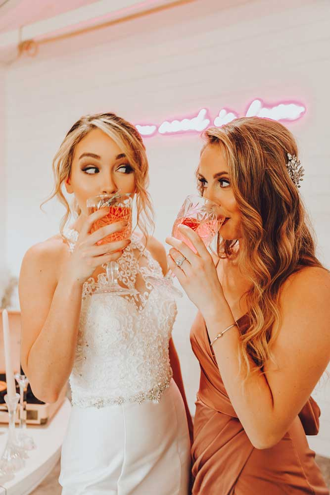 Bride and bride tribe glam having a drink