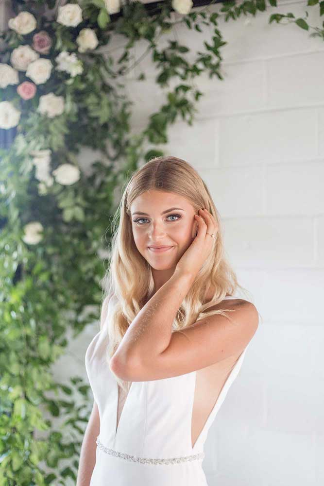 Bride styled with an editorial look by Jennifer