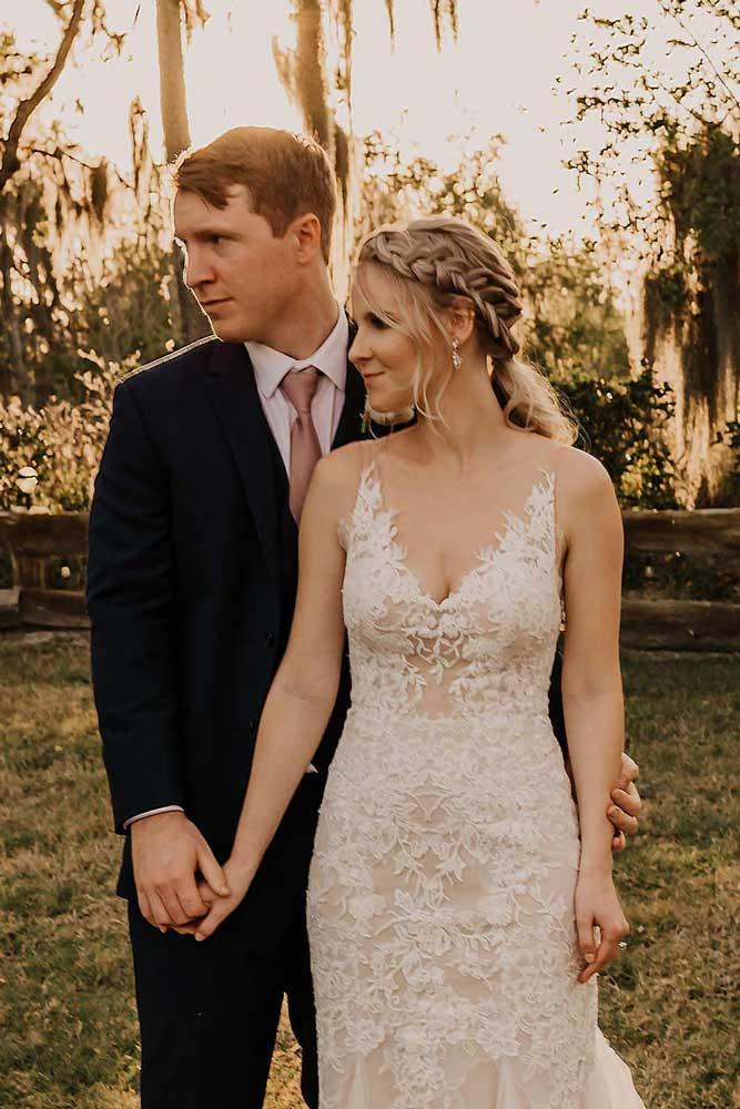 Groom behind bride who is styled with a braid and glowy makeup by Jennifer